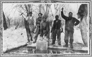 Men cutting ice blocks