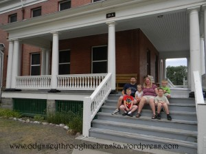 Garrison family in front of the house