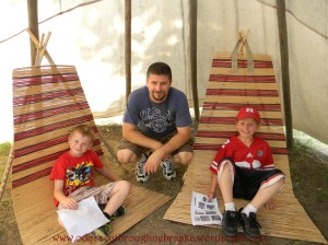 Kyle and boys inside the tepee