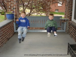 little boys on the porch